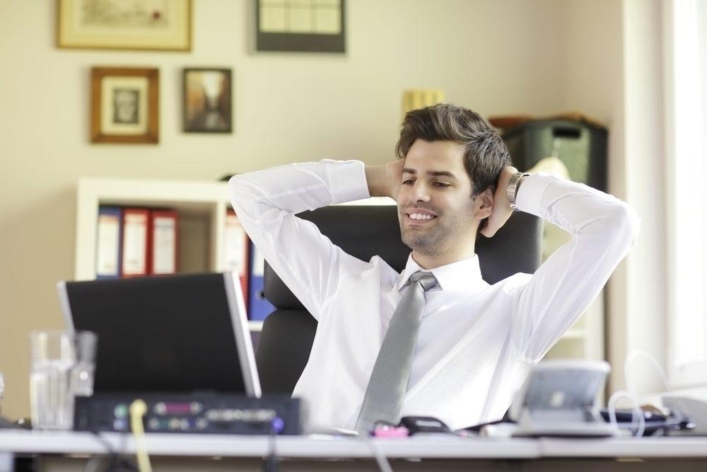Happy office worker businessman