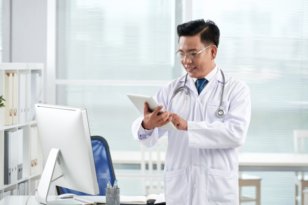 asian-doctor-using-medical-app-his-digital-device_